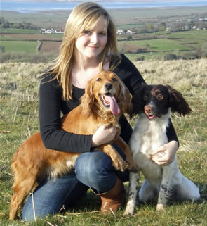 Aimee Robbins, who did work experience at Lains Shooting School, with Fudge (left) and Diva, two of the spaniels stolen from Lains Shooting School.